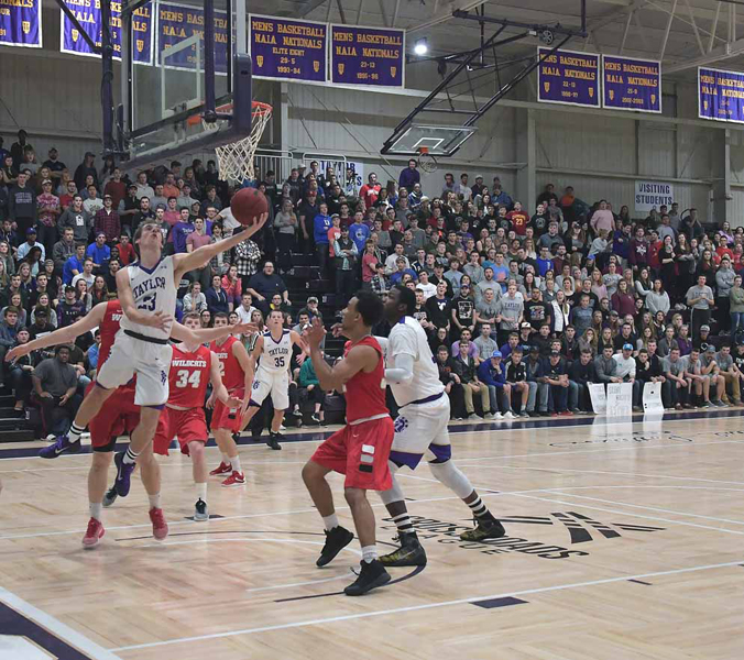 35th IWU Edges Past Trojans in Odle Photo